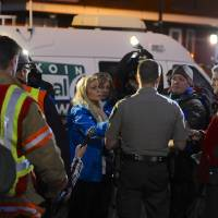 Photo - CORRECTS MALL LOCATION - Media gather around Clackamas County sheriff's Lt. James Rhodes during a news conference at the scene of a multiple shooting at Clackamas Town Center Mall in Portland, Ore., Tuesday Dec. 11, 2012. A gunman is dead after opening fire in the Portland, Ore., area shopping mall Tuesday, killing two people and wounding another, sheriff's deputies said. (AP Photo/Greg Wahl-Stephens)