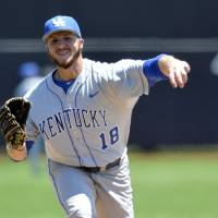 Photo - Kentucky's A.J. Reed pitches to Kent State during an NCAA college baseball regional tournament game in Louisville, Ky., Saturday, May 31, 2014. Kentucky won 4-2. (AP Photo/Timothy D. Easley)