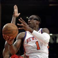 Photo -   New York Knicks' Amare Stoudemire (1) drives past Los Angeles Clippers' Reggie Evans during the first half of an NBA basketball game, Wednesday, April 25, 2012, in New York. (AP Photo/Frank Franklin II)