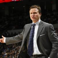 Photo - Oklahoma City head coach Scott Brooks argues a call during the NBA basketball game between the Oklahoma City Thunder and the Cleveland Cavaliers, Sunday, Dec. 13, 2009, at the Ford Center in Oklahoma City. Photo by Sarah Phipps, The Oklahoman ORG XMIT: KOD