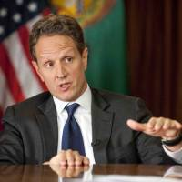 Photo - In this Nov. 30, 2012, photo provided by CBS News Treasury Secretary Timothy Geithner answers questions about averting the