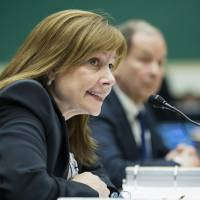 Photo - FILE - In this June 18, 2014 file photo, General Motors CEO Mary Barra testifies on Capitol Hill in Washington. Barra makes her second appearance before a Senate subcommittee investigating the company's handling of a defective ignition switch in small cars on Thursday, July 17, 2014. (AP Photo/Cliff Owen, File)