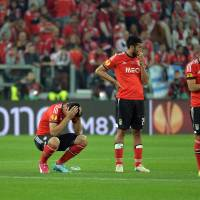 Photo - Benfica players react at the end of the Europa League soccer final between Sevilla and Benfica, at the Turin Juventus stadium in Turin, Italy, Wednesday, May 14, 2014.  Sevilla beat Benfica 4-2 on penalties to win the Europa League final. (AP Photo/Massimo Pinca)