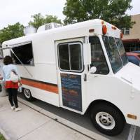 Photo - Waffle Champion, a mobile kitchen, serving sweet and savory waffles made to order parked on NW 23rd, Friday, April 20, 2012. Photo By David McDaniel/The Oklahoman