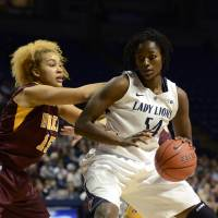 Photo - Penn State's Nikki Greene (54) works around Minnesota's Micaella Riche (15) during the first half of an NCAA college basketball game in State College, Pa., Thursday, Jan. 24, 2013. (AP Photo/Ralph Wilson)