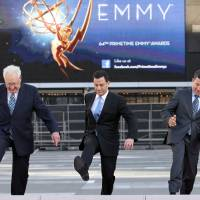 Photo -    Don Mischer, executive producer of the 64th Primetime Emmy Awards, left, host Jimmy Kimmel, center, and Television Academy chairman and chief executive Bruce Rosenblum attend the Emmy Awards Red Carpet Rollout at the Nokia Theatre on Wednesday, Sept. 19, 2012, in Los Angeles. The Emmy Awards will be held Sunday, Sept 23. (Photo by Matt Sayles/Invision/AP)