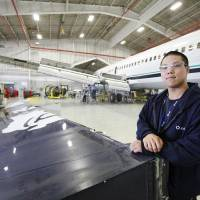 Photo - Sheet metal mechanic Phuong Le, 29, completed Francis Tuttle Technology Center's 288-hour course before joining AAR Aircraft Services in late 2009. He eventually plans to earn his airframe and power plant license. PHOTOS BY STEVE GOOCH, THE OKLAHOMAN