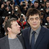 Photo - Actors Mathieu Amalric, left, and Benicio Del Toro pose for photographers during a photo call for the film Jimmy P. Psychotheraphy of a Plains Indian at the 66th international film festival, in Cannes, southern France, Saturday, May 18, 2013. (AP Photo/Francois Mori)