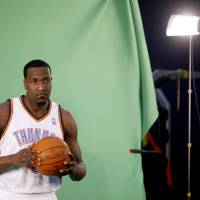 Photo - OKLAHOMA CITY THUNDER / NBA BASKETBALL: Oklahoma City's Kendrick Perkins films video segments at the Thunder practice facility, Saturday, Feb, 26, 2011, in Oklahoma City. Photo by Sarah Phipps, The Oklahoman  ORG XMIT: KOD