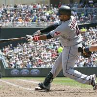 Photo -   Cleveland Indians' Carlos Santana hits the Indians third home run off Minnesota Twins pitcher Jason Marquis in the fifth inning of a baseball game, Tuesday, May 15, 2012, in Minneapolis. (AP Photo/Jim Mone)