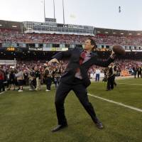 Photo - Former San Francisco 49ers quarterback Steve Young throws a ball on the field at Candlestick Park before the 49ers' NFL football game against the Atlanta Falcons in San Francisco, Monday, Dec. 23, 2013. The 49ers are playing their last regular-season game at Candlestick before moving a new stadium for the 2014 season. (AP Photo/Marcio Jose Sanchez)