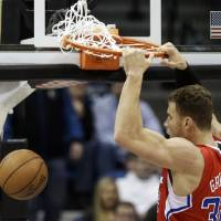 Photo - Los Angeles Clippers' Blake Griffin dunks in the first half of an NBA basketball game against the Minnesota Timberwolves Wednesday, Jan. 30, 2013 in Minneapolis. (AP Photo/Jim Mone)
