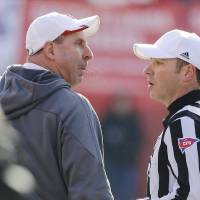 Photo - Nebraska head coach Bo Pelini, left, protests a pass interference call with referee Alex Kemp, right, in the third quarter of an NCAA college football game against Iowa in Lincoln, Neb., Friday, Nov. 29, 2013. Iowa won 38-17. (AP Photo/Nati Harnik)