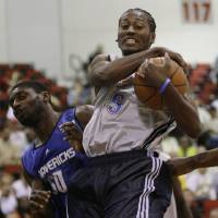 Photo - Oklahoma City Thunders' Kyle Weaver struggles to keep possession of the ball from Dallas Mavericks' Alfred Aboya during their NBA Summer League basketball game at Thomas & Mack Arena in Las Vegas on Saturday, July 18, 2009. (AP Photo/Laura Rauch) ORG XMIT: NVLR105