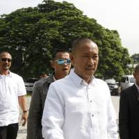 Photo -   Maguindanao Gov. Esmael Mangudadatu, second from right, whose wife and sister were among those who were killed in the Nov. 23, 2009 massacre of 57 people, in Maguindanao province in the southern Philippines, arrives to testify in the ongoing trial Wednesday, June 27, 2012, at a detention cell which has been converted into a courtroom at Camp Bagong Diwa in Taguig city southeast of Manila, Philippines. Prosecutor Nena Santos said Wednesday a man who was fatally shot in February was a potential witness in the massacre. The victim was the latest of six witnesses, would-be witnesses and their relatives who have been gunned down since the massacre trial began in 2010. (AP Photo/Bullit Marquez)