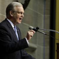 Photo - Missouri Gov. Jay Nixon delivers the annual State of the State address to a joint session of the House and Senate Monday, Jan. 28, 2013, in Jefferson City, Mo. (AP Photo/Jeff Roberson)