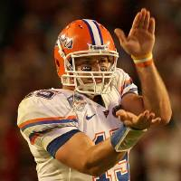 Photo - Florida quaterback Tim Tebow was assessed a personal foul penalty for flashing the Gator chomp at the OU defense during the BCS National Championship game. Photo by Tim Casey, gatorcountry.com ORG XMIT: 0908182208215291