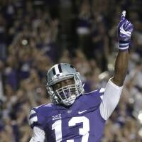 Photo - Kansas State wide receiver Steven West (13) celebrates after scoring a touchdown during the second half of an NCAA college football game against Stephen F. Austin Saturday, Aug. 30, 2014, in Manhattan, Kan. (AP Photo/Charlie Riedel)