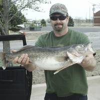 Photo -  Ken Flowers of Oklahoma City caught this 9-pound, 12-ounce walleye Thursday at Lake Hefner at 10:30 p.m. near the water canal inlet.