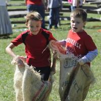 Photo -   Tyler Lemay, left, and Dylan McGhee compete in the sack race during the 33rd annual Tennessee Fall Homecoming at the Museum of Appalachia Thursday, Oct. 11, 2012, in Clinton, Tenn. The Museum of Appalachia is holding its 33rd Tennessee Fall Homecoming in Norris this weekend. (AP Photo/Knoxville News Sentinel, Amy Smotherman Burgess)