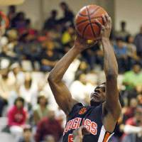 Photo - Douglass High School basketball player Stephen Clark, shown here during a February 2012 game in Oklahoma City, committed to play college basketball at Oklahoma State on Friday. PHOTO BY NATE BILLINGS, The Oklahoman Archive  NATE BILLINGS