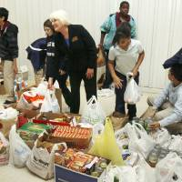 Photo - DEPARTMENT OF HUMAN SERVICES / DONATE / DONATION: Belle Isle middle school principal Lynn Kellert works with students as they sort collected food which will be donated to the DHS from Belle Isle Middle School in Oklahoma City, OK, Thursday, Nov. 13, 2008. BY PAUL HELLSTERN, THE OKLAHOMAN ORG XMIT: KOD