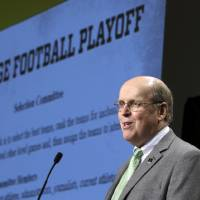 Photo -                    College Football Playoff executive director Bill Hancock speaks to the media at the Big 12 football media days.                     AP Photo