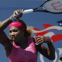 Photo - Serena Williams, of the United States, returns a shot to Vania King, of the United States, during the second round of the 2014 U.S. Open tennis tournament, Thursday, Aug. 28, 2014, in New York. (AP Photo/Elise Amendola)