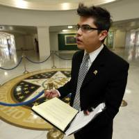 Photo - University of Oklahoma student Eleazar Velazquez, 23,  speaks with a reporter recently as he lobbies against SB 423 at the state Capitol.