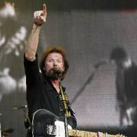 Photo -  Ronnie Dunn performs during the Oklahoma Twister Relief Concert, benefiting victims of the May tornadoes, at Gaylord Family - Oklahoma Memorial Stadium on the campus of the University of Oklahoma in Norman, Okla., Saturday, July 6, 2013. Photo by Nate Billings, The Oklahoman