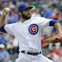 Photo - Chicago Cubs starter Jake Arrieta throws against the Colorado Rockies during the first inning of a baseball game in Chicago, Thursday, July 31, 2014. (AP Photo/Nam Y. Huh)