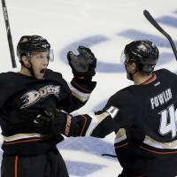 Photo - Anaheim Ducks center Nick Bonino, left, celebrates his game winning goal with Cam Fowler, against the Detroit Red Wings during overtime in Game 5 of their first-round NHL hockey Stanley Cup playoff series in Anaheim, Calif., Wednesday, May 8, 2013.  The Ducks won 3-2 in overtime.(AP Photo/Chris Carlson)