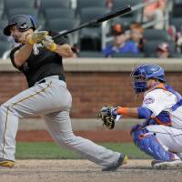 Photo - Pittsburgh Pirates first baseman Gaby Sanchez (17) follows through on a base hit that scored Neil Walker and Andrew McCutchen during the ninth inning of a baseball game, Monday, May 26, 2014, in New York. The Pirates won 5-3. (AP Photo/Julie Jacobson)