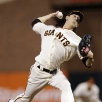 Photo -   San Francisco Giants pitcher Tim Lincecum delivers in the sixth inning during Game 2 of the National League division baseball series against the Cincinnati Reds in San Francisco, Sunday, Oct. 7, 2012. (AP Photo/Marcio Jose Sanchez)