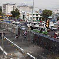 Photo -   The street where Mexico's Congress is located is shown blocked by a metal barricade in Mexico City, Monday, Nov. 26, 2012. Police heightened security around the building where Mexico's President-elect Enrique Pena Nieto, of the Institutional Revolutionary Party (PRI) will be sworn-in on Dec. 1. (AP Photo/Eduardo Verdugo)
