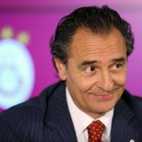 Photo - Former Italy national soccer team coach Cesare Prandelli during a signing ceremony with Galatasaray in Istanbul, Turkey, Tuesday, July 8, 2014. Prandelli signed a two-year contract with the Istanbul side on Tuesday, replacing another Italian, Roberto Mancini. Prandelli resigned from Italy immediately after the Azzurri's loss to Uruguay in the World Cup, which consigned his team to a disappointing group stage exit.(AP Photo/Emrah Gurel)