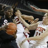 Photo - Stanford forward Chiney Ogwumike, left, pulls a rebound away from Southern California forward Cassie Harberts, right, and Kiki Alofaituli during the second half of an NCAA women's basketball game in Los Angeles, Friday, Feb. 15, 2013. Stanford defeated Southern California 79-55.  (AP Photo/Chris Carlson)