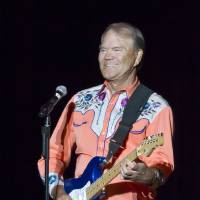 Photo - FILE - This Sept. 6, 2012 file photo shows singer Glen Campbell performing during his Goodbye Tour in Little Rock, Ark. Campbell will be in Washington, D.C., Monday, April 22, 2013, advocating for Alzheimer's disease research. The trip includes attendance at a fundraising dinner for the Alzheimer's Association and a visit to Capitol Hill where he'll appear to underscore the importance of Alzheimer's research on a visit to the Senate. (AP Photo/Danny Johnston, file)