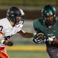 Photo - Edmond Santa Fe's Calvin Harkless II rushes during the high school football game between Edmond Santa Fe and Union at Wantland Stadium in Edmond, Okla.,  Friday, Nov. 16, 2012. Photo by Sarah Phipps, The Oklahoman