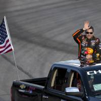 Photo - Sprint Cup Series driver Tony Stewart waves to the crowd before the start of the NASCAR Sprint Cup auto race at Atlanta Motor Speedway Sunday, Aug. 31, 2014, in Hampton, Ga. Stewart was racing for the first time since being involved in a fatal dirt track accident in upstate New York. (AP Photo/John Bazemore)