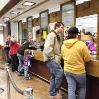 Photo - Students stand in line to enroll for the spring semester at Rose State College. PHOTO BY JIM BECKEL, THE OKLAHOMAN