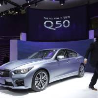 Photo - Infiniti's new Q50 is displayed at the Shanghai International Automobile Industry Exhibition (AUTO Shanghai) media day in Shanghai, China Saturday, April 20, 2013. (AP Photo/Eugene Hoshiko)