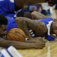 Photo - New York Knicks forward Carmelo Anthony, right, and guard Iman Shumpert, left, who had offseason surgery to correct a torn left ACL, take part in a training session at the 02 arena in London, Wednesday, Jan. 16, 2013.  The Detroit Pistons are due to play a