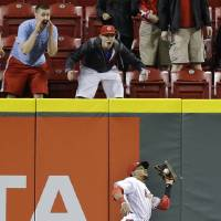 Photo - Cincinnati Reds center fielder Billy Hamilton catches a fly ball hit by Chicago Cubs' Starlin Castro in the sixth inning of a baseball game, Tuesday, April 29, 2014, in Cincinnati. (AP Photo)