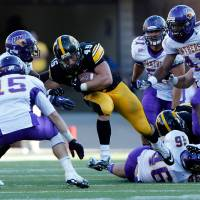 Photo -   Iowa Hawkeyes fullback Mark Weisman (45) tries to run through Northern Iowa Panthers defensive back Wilmot Wellington (20) defensive back Garrett Scott (15) during the second half of an college football game Saturday, Sept. 15, 2012 at Kinnick Stadium in Iowa City. (AP Photo/The Gazette, Brian Ray)