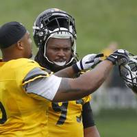 Photo - Pittsburgh Steelers outside linebacker LaMarr Woodley, left, gives linebacker Jarvis Jones a few pointers at practice during NFL football training camp at the team's training facility in Latrobe, Pa. on Wednesday, July 31, 2013 . (AP Photo/Keith Srakocic)