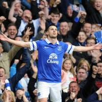 Photo - Everton's Kevin Mirallas celebrates after he scores the second goal of the game for his side during their English Premier League soccer match against Manchester United at Goodison Park in Liverpool, England, Sunday April 20, 2014. (AP Photo/Clint Hughes)