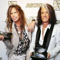 Photo - FILE - In this April 8, 2013 photo, Steven Tyler, left, and Joe Perry, recipients of the ASCAP Founders Award, pose with their awards at the ASCAP Press Conference held at the Sunset Marquis, in Los Angeles. Tyler and Perry will be honored with the award during ASCAP's 30th annual Pop Music Awards at a gala on April 17, 2013, in Los Angeles. (Photo by Eric Charbonneau/Invision/AP, File)
