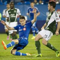 Photo - Montreal Impact's Maxim Tissot tries to block the pass of Portland Timbers' Danny O'Rourke during second half MLS action in Montreal on Sunday, July 27, 2014. (AP Photo/The Canadian Press, Peter McCabe)