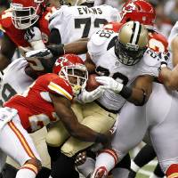 Photo -   New Orleans Saints running back Pierre Thomas (23) carries as Kansas City Chiefs strong safety Eric Berry (29) tackles in the first half of an NFL football game at the Mercedes-Benz Superdome in New Orleans, Sunday, Sept. 23, 2012. (AP Photo/Jonathan Bachman)